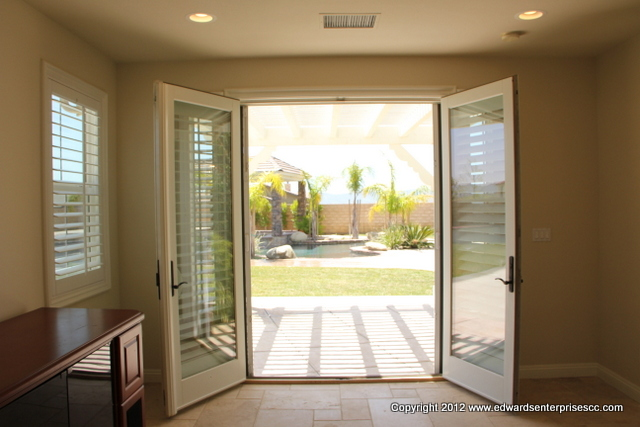 Sliding Screen Door Repairs and adjustments: Edward's Enterprises Mirror-glass-screen.