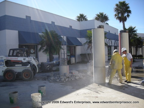 Demolition of a commercial shopping center kiosk & flower stand down to the ground