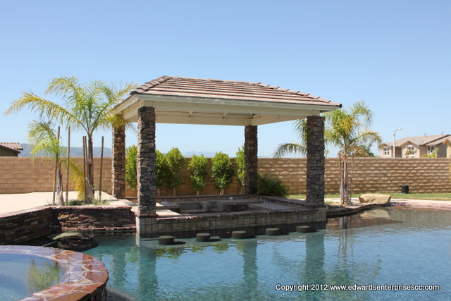 A free standing pergola repaired & painted over a sunken BBQ area poolside.