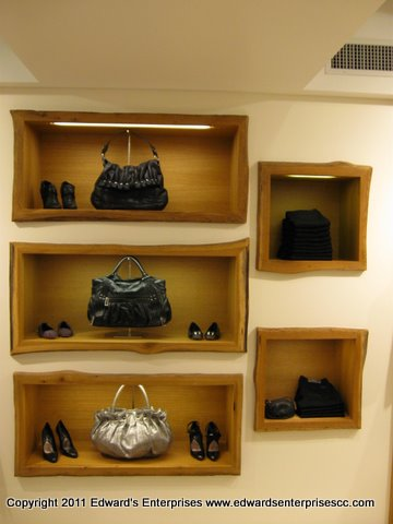 Edward's Enterprises Santa Barbara Store Cabinet lighting replaced: Retail cabinet lighting for purse display cases with new special order ballasts and bulbs.