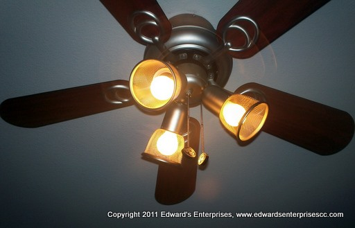 A newly installed light kit working on a ceiling fan for a residential client