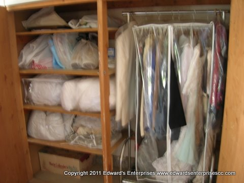 Edward's Enterprises Closet Organizer Repair Services in Los Angeles, CA 90024, 90025, 90034, 90049 and 90064: Spacious, practical closet space constructed for a customer's many clothing needs.
