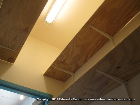 Overhead closet shelving for max space in Carpinteria. Edward's Enterprises makes it possible with just a call