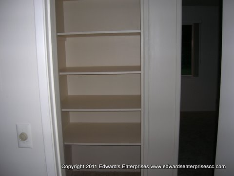 Edward's Enterprises Closet Shelving Service in Los Angeles, CA 90024, 90025, 90034, 90049 and 90064: A hallway closet in a typical residence, created for easy family access by.