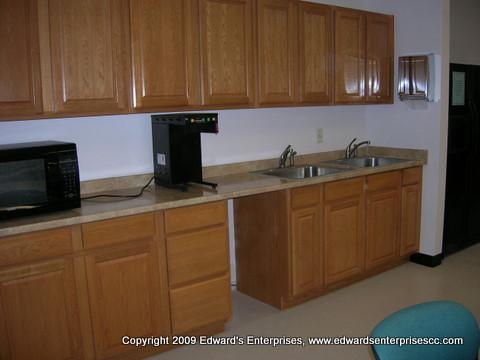 An office break room remodel including tile, cabinets, drywall, paint, & more: Edward's Enterprises