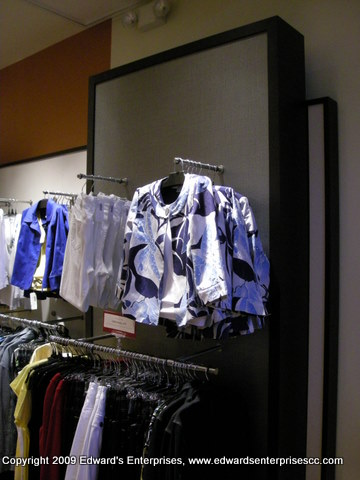 Clothing rack & hanging fixtures installed & secured to walls.