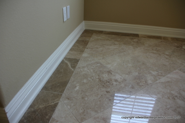 White wood baseboards replaced & installed where missing in a residential  home