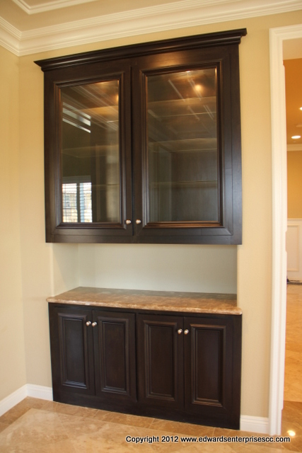 Cabinets with tastefull puck lighting installed in Studio City, CA 91604 home.
