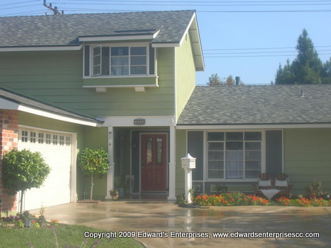 Prep, prime, & paint the exterior siding, trim & stucco of a 2 story home