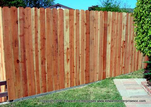 Los Angeles (West) redwood fencing installed to divide 2 properties along a side yard