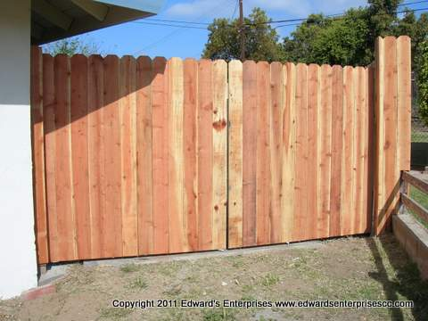 Double side yard gate faced with 6 inch redwood dogear 6 foot pickets