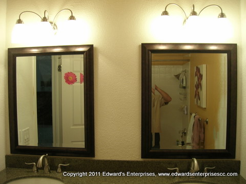 Mirror, Glass, and Screen: 2 framed mirrors hung up: Edward's Enterprises Mirror-Glass-Screen.