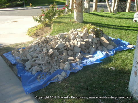 Debris pile left from demolishing old block pillars in front of our customers home, ready to be hauled away