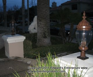 Entryway to a residential remodel project : Landscape Lighting and column top lights installed at a customer's home: Edward's Enterprises Landscape Light.
