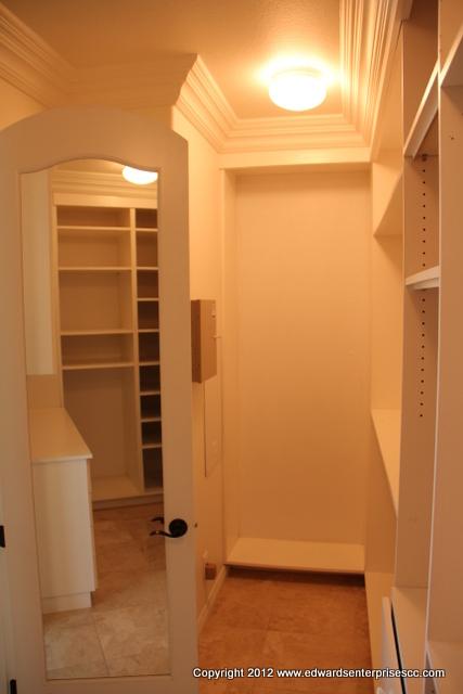A master bedroom closet in a home residence, created for easy family access: Edward's Enterprises Carpinteria Closet Organizer.
