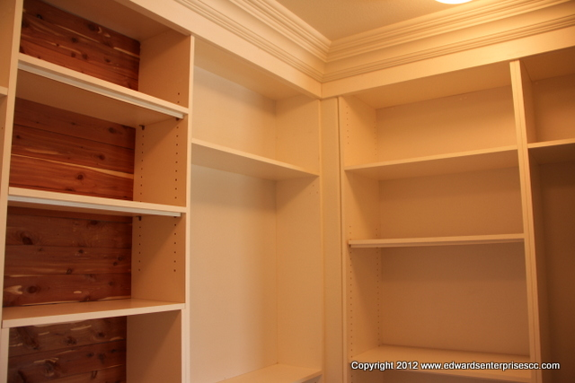 A master bedroom closet in a Carpinteria home residence, created for easy family access: Edward's Enterprises Closet Organizer.