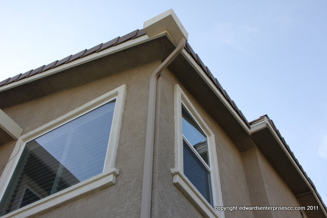 Rain Gutter Downspout Cleaned Reattached Repaired