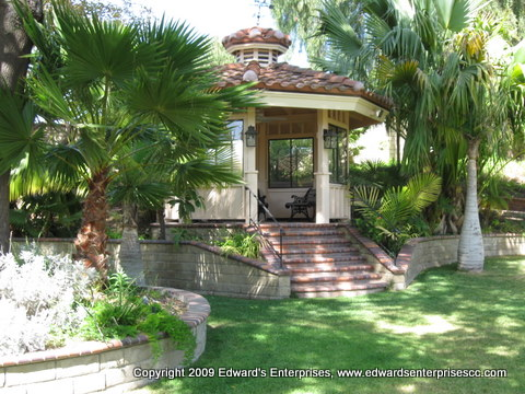Residential Remodeling Project: Gazebo with palm trees around it repaired for residential remodeling project by Edward's Enterprises which included extensive exterior and interior work such as fascia, roofing, painting, electrical, plumbing and more.