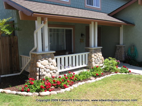Front of home remodeled & arches replaced with craftsmen style pillars, stone, posts & more