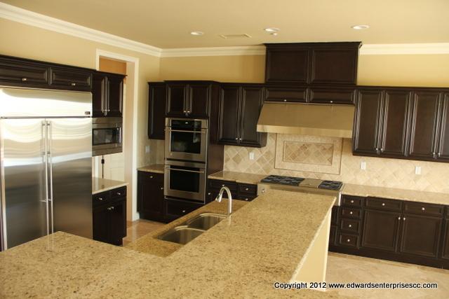 Stainless Steel Kitchen Hoods installation in kitchen remodel.