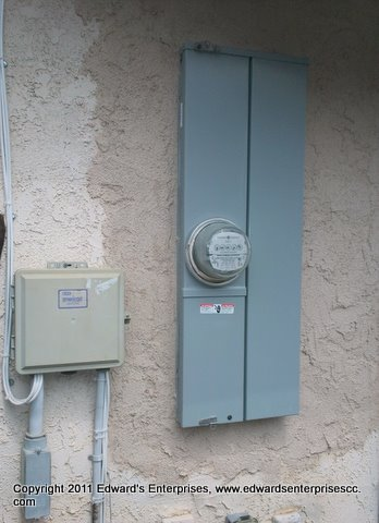 Stucco repair around a residential electrical box.