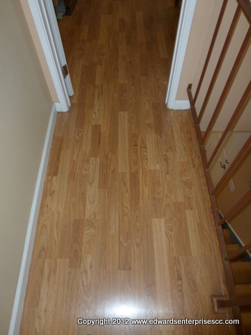 Residential Laminate Flooring installed on a landing of a second story home