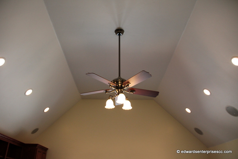 A new ceiling fan hung up high for a customer to enjoy.