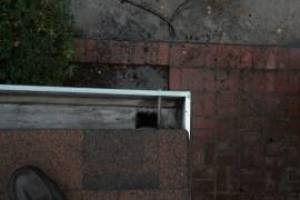 Landscaping Rain Gutter Cleaning Dirt Debris