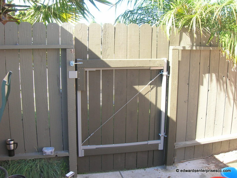 Residential painted pedestrian gate rebuilt using metal gate hardware kit, treated 2X4s & 6 foot dog ear pickets.