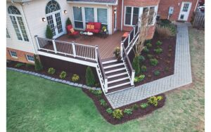 Freshly painted deck with new landscaping surrounding it