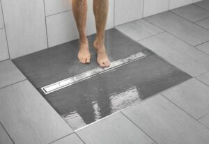 Modern shower design, shower pan is flush with stone tile floor