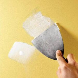 Drywall repair, application of spackle to small holes