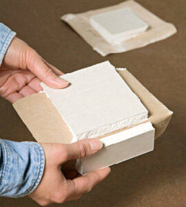 Drywall squares for use in patching drywall holes