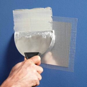 Application of spackle and mesh to repair drywall