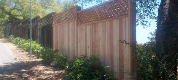 Fence with new extension installed at the end