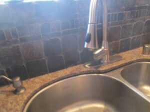 Clean, new faucet after photo