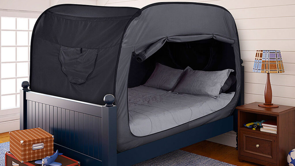 Bed with tent enclosure in child's bedroom