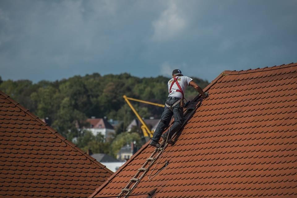 Roofer repairing steep roof