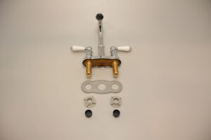 Faucet laid out in parts, with plastic nuts, washers, and gasket