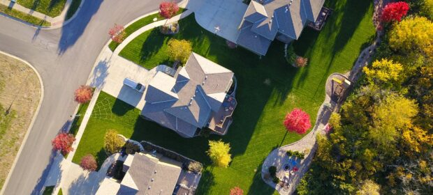 Bird's eye view of neighborhood with green lawns