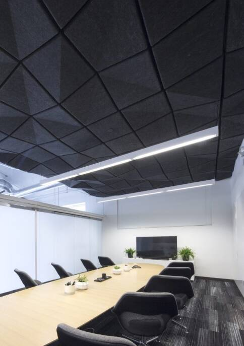 Artsy black acoustic ceiling tile in a conference room