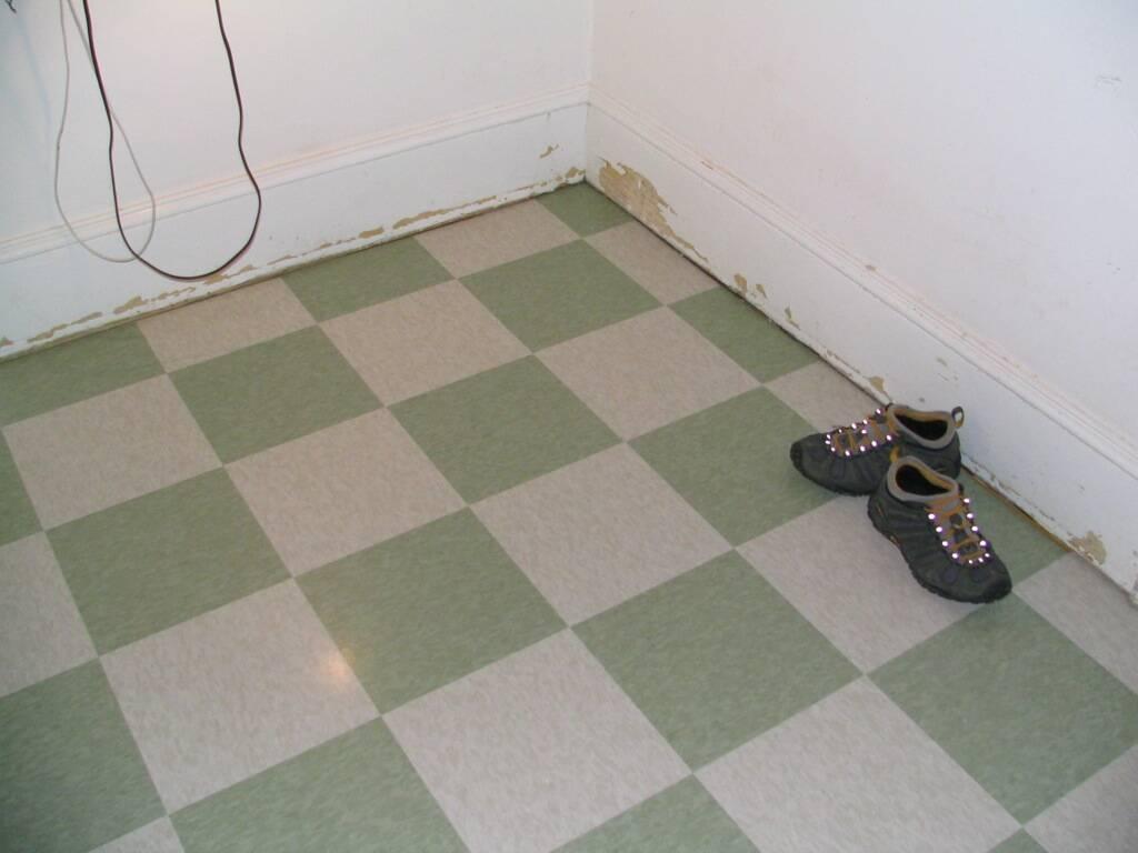 Beige and unsaturated green vinyl floor tile